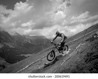 LEOGANG, AUSTRIA - JUNE 13, 2014: Greg Minnaar of Santa Cruz Syndicate is seen during training of the UCI Downhill Mountain Bike World Cup in Leogang, Austria.