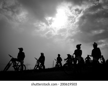 LEOGANG, AUSTRIA - JUNE 13, 2014: Riders line up for training during the UCI Downhill Mountain Bike World Cup in Leogang, Austria.