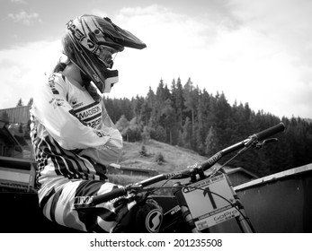 LEOGANG, AUSTRIA - JUNE 14, 2014: Manon Carpenter of Madison Saracen Factory Team is seen during training of the UCI Downhill Mountain Bike World Cup in Leogang, Austria.