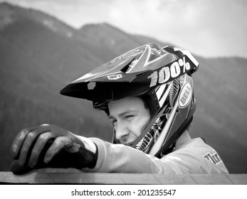 LEOGANG, AUSTRIA - JUNE 14, 2014: Sam Blenkinsop of Lapierre Gravity Republic is seen during training of the UCI Downhill Mountain Bike World Cup in Leogang, Austria.