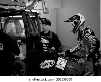 LEOGANG, AUSTRIA - JUNE 14, 2014: Sam Hill (r) of CRC/Nukeproof is seen with team mechanic Jacy Shumilak as they board the cable car for Qualification at the UCI Downhill Mountain Bike World Cup.