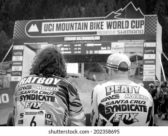 LEOGANG, AUSTRIA - JUNE 14, 2014: Josh Bryceland and Steve Peat of Santa Cruz Syndicate are seen watching the results of Qualification at the UCI Downhill Mountain Bike World Cup in Leogang, Austria.