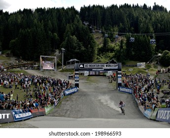 LEOGANG, AUSTRIA - JUNE 15, 2014: Josh Bryceland of Santa Cruz Syndicate arrives in the finish area after his winning run at the UCI Mountain Bike Downhill World Cup at the Leogang race course.