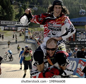 LEOGANG, AUSTRIA - JUNE 15, 2014: Josh Bryceland of Santa Cruz Syndicate is celebrated for his first World Cup win by team mate Steve Peat at the UCI Mountain Bike Downhill  World Cup in Leogang.