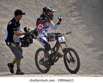 LEOGANG, AUSTRIA - JUNE 15, 2014: Josh Bryceland of Santa Cruz Syndicate celebrates his winning run at the UCI Mountain Bike Downhill World Cup at the Leogang race course.