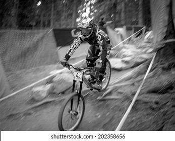 LEOGANG, AUSTRIA - JUNE 15, 2014: Sam Hill of CRC/Nukeproof is seen during pre-final training at the UCI Downhill Mountain Bike World Cup in Leogang, Austria.