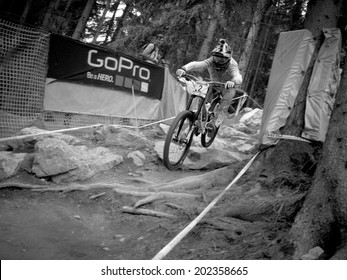 LEOGANG, AUSTRIA - JUNE 15, 2014: Troy Brosnan of Specialized Racing DH is seen during pre-final training at the UCI Downhill Mountain Bike World Cup in Leogang, Austria.