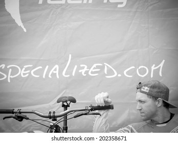 LEOGANG, AUSTRIA - JUNE 15, 2014: Aaron Gwin of Specialized Racing DH is seen in the team's pit before the final of the UCI Downhill Mountain Bike World Cup in Leogang, Austria.
