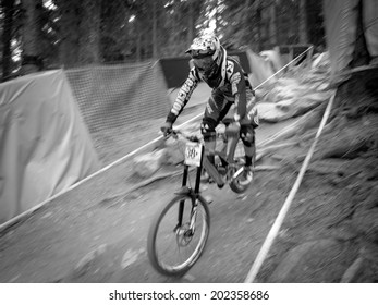 LEOGANG, AUSTRIA - JUNE 15, 2014: Mike Jones of CRC/Nukeproof is seen during pre-final training at the UCI Downhill Mountain Bike World Cup in Leogang, Austria.
