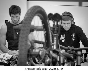 LEOGANG, AUSTRIA - JUNE 15, 2014: Gee Atherton (l) and Taylor Vernon (r) of GT Factory Racing are seen preparing for the finals of the UCI Downhill Mountain Bike World Cup in Leogang, Austria.