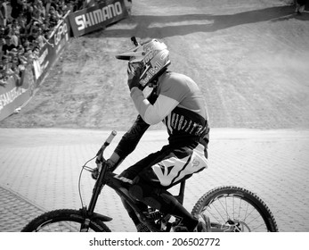 LEOGANG, AUSTRIA - JUNE 15, 2014: Loic Bruni of Lapierre Gravity Republic looks in disbelief after his race run in the final of the UCI Downhill Mountain Bike World Cup in Leogang, Austria.