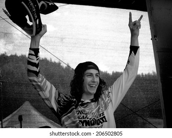 LEOGANG, AUSTRIA - JUNE 15, 2014: Josh Bryceland of Santa Cruz Syndicate celebrates during podium ceremony winning the UCI Downhill Mountain Bike World Cup in Leogang, Austria.