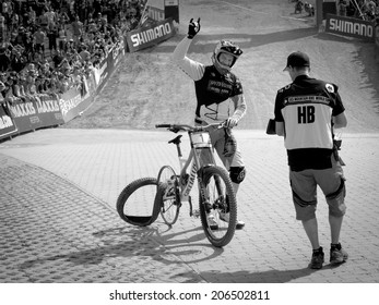 LEOGANG, AUSTRIA - JUNE 15, 2014: Aaron Gwin of Specialized Racing DH is seen at the finish area after finishing his race run on a rim at the UCI Downhill Mountain Bike World Cup in Leogang, Austria.