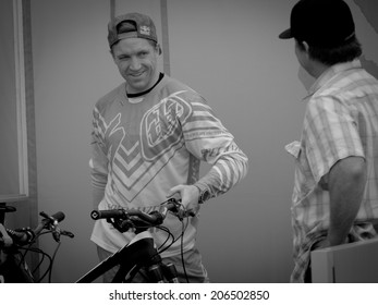 LEOGANG, AUSTRIA - JUNE 15, 2014: Aaron Gwin of Specialized Racing DH is seen at the team's pit area before the final of the UCI Downhill Mountain Bike World Cup in Leogang, Austria.