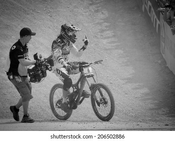 LEOGANG, AUSTRIA - JUNE 15, 2014: Josh Bryceland of Santa Cruz Syndicate is seen in the finish area after his winning race run at the UCI Downhill Mountain Bike World Cup in Leogang, Austria.