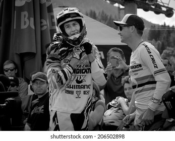 LEOGANG, AUSTRIA - JUNE 15, 2014: Josh Bryceland of Santa Cruz Syndicate ( l ) is seen in the hot seat area after his winning race run at the UCI Downhill Mountain Bike World Cup in Leogang, Austria.