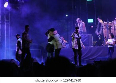 Leon, Mexico. Jan 20, 2019: Fan hugs DJ Kane at Kumbia Kings Concert by 443th anniversary of Leon's foundation during Feria de Leon 2019
