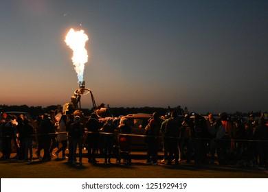 Leon, Mexico. Nov 16, 2018: Pilot testing hot air system during Festival Internacional del Globo 2018 (International Hot Air Balloon Fest)