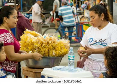 Leon, Nicaragua - March 10, 2018: Nicaraguan woman of scarce resources selling on the street