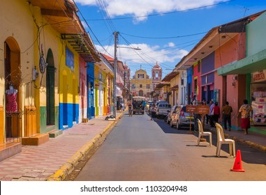 LEON, NICARAGUA, MAY, 16, 2018: Outdoor view of people on a street in Leon, Nicaragua, is the second poorest country in Central America, four out of ten people earn less than a dollar a day
