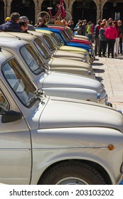 LEON, SPAIN - APRIL 27, 2014:  XIV International Concentration of SEAT 600 in in the Plaza Mayor of Leon. Vehicle manufactured in Spain between 1957 and 1973.