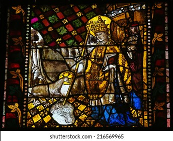 LEON, SPAIN - JULY 17, 2014: Stained glass window depicting a saint in the cathedral of Leon, Castille and Leon, Spain.