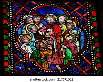 LEON, SPAIN - JULY 17, 2014: Stained glass window depicting Jesus and the apostles in the cathedral of Leon, Castille and Leon, Spain. Thomas the Apostle touches Jesus' wound.