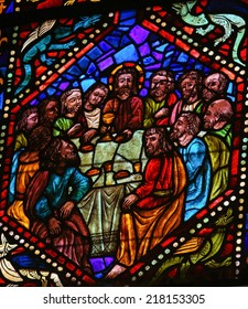 LEON, SPAIN - JULY 17, 2014: Stained glass window depicting Jesus and the apostles at the Last Supper in the cathedral of Leon, Castille and Leon, Spain.
