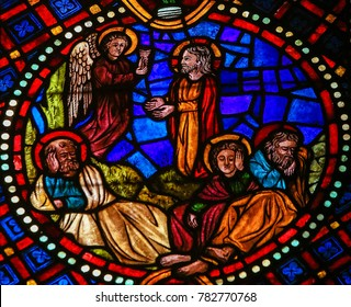 Leon, Spain - July 17, 2014: Stained glass window depicting Jesus in the Garden of Gethsemane on Maundy Thursday, in the cathedral of Leon, Castille and Leon, Spain.