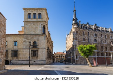 LEON, SPAIN - JUN 12, 2017: On the left is the Guzman Palace (16th century), on the right is the Botines House (1892)