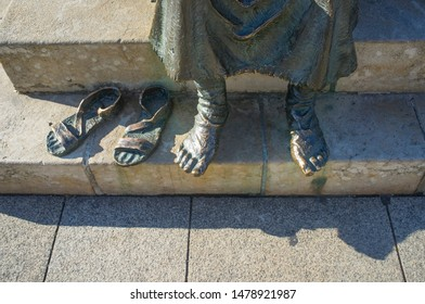 Leon, Spain - June 26th, 2019: Monument To The Pilgrim at San Marcos Square, Leon City, Castile and Leon, Spain. Tired feet detail