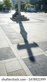 Leon, Spain - June 26th, 2019: Monument To The Pilgrim at San Marcos Square, Leon City, Castile and Leon, Spain. Shadow of the Cross on floor