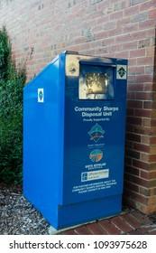 Leongatha, Australia - January 28, 2018: community sharps disposal unit in Leongatha in South Gippsland. The sharps disposal unit is for disposal of syringes and needles.