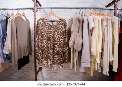 leopard pattern clothes on hangers. coats ,clothes in a row on shop