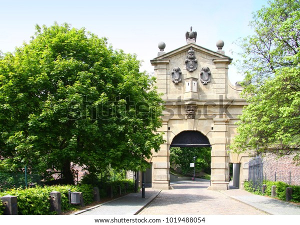 The Leopold Gate in the Prague part of Vysehrad is a monument to the history of Prague and the Czech Republic. It is part of the walls. Trees and greenery surround the surroundings.