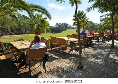 Lepe, Huelva, Spain - October 28, 2010: people sitting on the bar terrace of the clubhouse, golf course of Islantilla, Lepe, province of Huelva, Andalusia, Spain