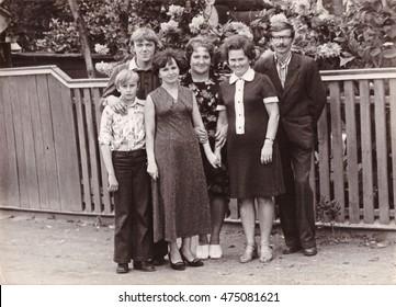 LEPEL, BELARUS - CIRCA 1980: Group black and white family photo at celebration of wedding of relative (vintage photo, approximately 1980's year)