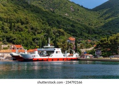 LEPETANE, MONTENEGRO - JULY 17: Ferry transports tourists and cars from Lepetane - Kamenari at Bay of Kotor (Boka Kotorska), on July 17, 2014 in Lepetane, Montenegro.