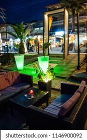 Leptokarya, Greece - June 25, 2018: Cafes on the seashore, with night lighting and beautiful decoration, night photography
