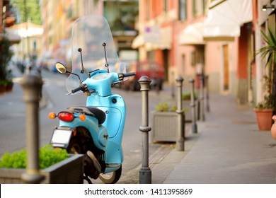 LERICI, ITALY - NOVEMBER 20, 2018: Motorbike parked on beautiful medieval street of Lerici town, located in the province of La Spezia in Liguria, part of the Italian Riviera, Italy.