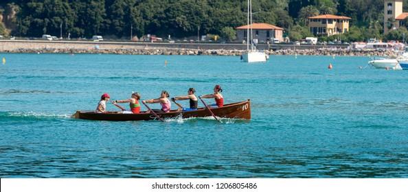 LERICI, LA SPEZIA, LIGURIA, ITALY, JULY 19, 2014: The female rowing team of Lerici trains in the waters of the Gulf of La Spezia for the Palio del Golfo