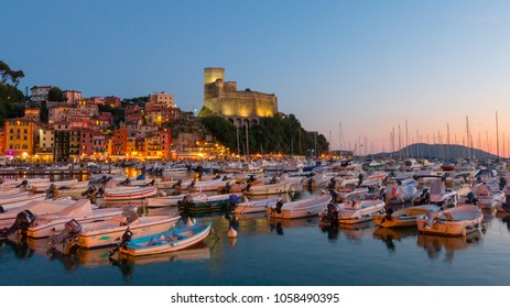Lerici, Liguria, Italy; 2nd July 2017; Small Boats in Harbour at Pretty Tourist Town of Lerici.  Blue Hour.