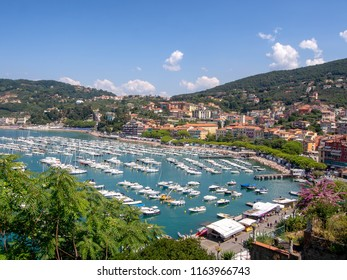LERICI, LIGURIA, ITALY - AUGUST 18, 2018: View across the bay of popular tourist destination of Lerici on the Mediterranean coast, Italy. Busy sunny summer day. Looking towards San Terenzo village.