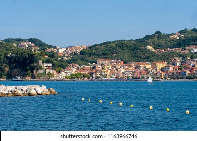 LERICI, LIGURIA, ITALY - AUGUST 18, 2018: View across the bay of popular tourist destination of Lerici to San Terenzo village. Mediterranean coast, Italy. Busy sunny summer day.
