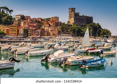LERICI (SP), ITALY - JUNE 21, 2018: The waters are wetting the hulls of the boats in the marina of Lerici