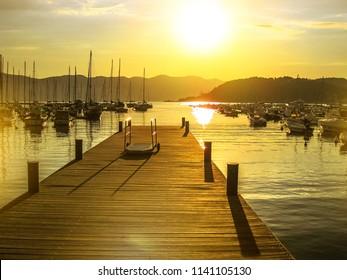 Lerici sunset wooden jetty at sunset light in Lerici town. La Spezia province, Ligurian Coast, Italy.