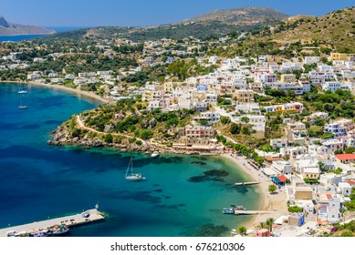 Leros island, Greece - May 31, 2017: aerial view of the coastline and the Panteli village, a traditional Greek village with white buildings and fishing boats