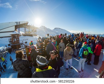 Les 2 Alps ski resort, France. February 10, 2017. People having fun at the bar in Alps. Winter party.