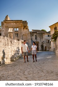 Les Baux de-Provence, Provence, France. couple mid age men and woman visiting old town of Les Baux - Shutterstock ID 1910748166