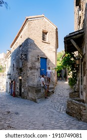 Les Baux de-Provence, Provence, France. couple mid age men and woman visiting old town of Les Baux - Shutterstock ID 1910749081